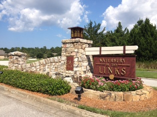 waterbury by the links sign